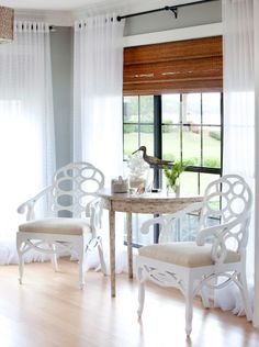 Gray, white, yellow seating, bamboo blinds and fresh, white sheers at the window