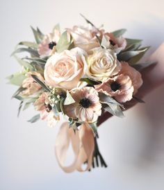 Blush apricot roses, vanilla roses, dusty miller and eucalyptus in silk flowers with dried brunia in this wedding bouquet by Holly's Wedding Flowers. Silk Bridal Bouquet, Blush Bouquet, Flower Bouquet Wedding, Bridesmaid Bouquet, Bridal Bouquets, Flower Bouquets, Purple Bouquets, Fresh Flower Bouquet, Small Wedding Bouquets