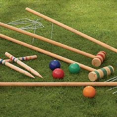 Wooden Croquet Set  Lawn croquet developed from the game of 'paille maille' (Pall Mall) with Charles II a fashionable advocate of the early game. It was introduced from France where a large ball was struck through hoops at either end of a long alley.