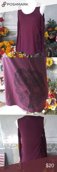 Plum cold shoulder top Plum long sleeve with skulls on both hips. Cold shoulder. Hot Topic sizing tends to run slightly big so as I usually wear a small, buying an extra small fit pretty well. Hot Topic Tops Tees - Long Sleeve
