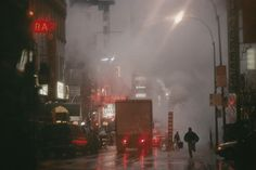 Steam pours over the streets of Broadway's Time Square, November 1987.