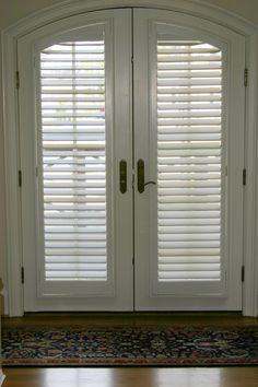 Beautiful French doors with arched windows covered with our custom plantation shutters. Plantation shutters look great from the inside and outside views. Wooden Window Shutters, Interior Window Shutters, Wooden Doors, Shutters Inside, Inside Doors, Internal Glazed Doors, Internal French Doors, Double Doors, Wood Exterior Door