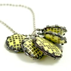 N E C K L ^ C E S - arthur hash: wearable objects  close up of tabs