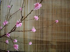 Japanese  party idea. Scrunched up paper on brances for cherry blossems.