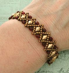 Linda's Crafty Inspirations: Bracelet of the Day: Liz – Matte Gold & Ruby - DIY Schmuck Seed Bead Jewelry, Bead Jewellery, Fine Jewelry, Women Jewelry, Fashion Jewelry, Jewelry Making, Seed Beads, Ruby Jewelry, Jewelry Stand
