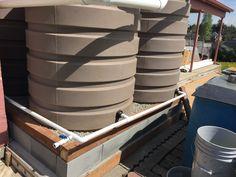 4 X 420 gallon rain tanks in Seattle's Rainier Valley neighborhood.  #rainwaterharvesting
