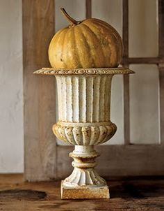 love the old urn and color of the pumpkin