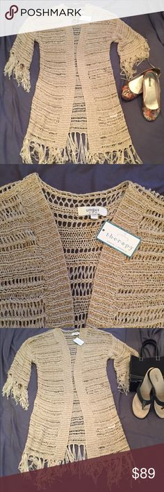 NWT crocheted wrap This was purchased in Memphis in the summer of 2015. It had never been worn. Tag is attached. Made from 65% cotton & 35% polyester. Hand washing is recommended. The fringe is very unique. This is a very nice piece to add to your wardrobe. Very versatile. Perfect condition. Fits small to medium. Made by UMGEE usa UMGEE usa Jackets & Coats