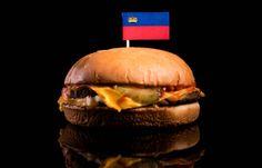 liechtenstein flag on top of hamburger isolated on black background