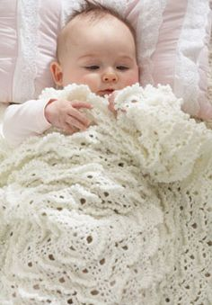 A vintage-inspired baby blanket that will be treasured in the family for generations. Crocheted in Patons Beehive Baby Fingering.