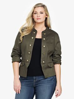 Arm yourself with fashion-forward style in this olive green jacket. Military-inspired details like the button accents along the open front are softened by a feminine silhouette. Faux flap pockets.