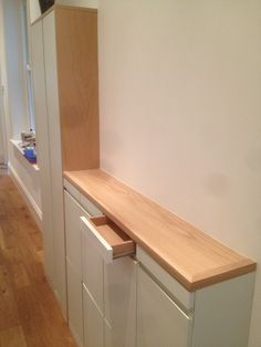 Slim hallway storage unit. By fine balance carpentry.
