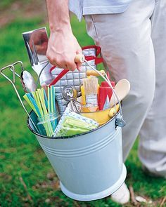 Bucket Caddy Use an empty pail to carry all your picnic essentials — grilling tools, drinking straws, condiments — to the table.