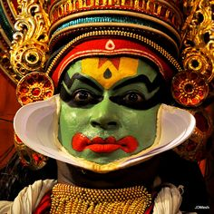 The painted face of a Kathakali performer  by JD Mesh