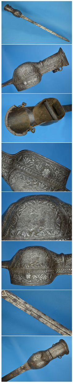 Indian (South, Deccan) pata sword, 17th c, this type appears to be a slightly earlier variant, and further up the the timeline in transition from the hooded katar to pata sword. The sword employs a long European style flexible blade, marked with two crescent moons on each side. The steel hilt is profusely and elaborately chiselled with floral and geometric patters. The hand grip bar is pinned to the guard with very decorative floral steel rivet heads, length: 44in (1115mm). Blade 32.5in…