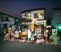 The Ukita Family in front of their home with all of their possessions, Tokyo, Japan. Published in Material World: A Global Family Portrait, ...