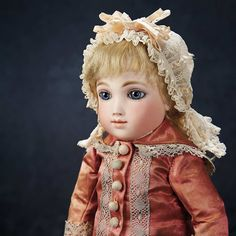 Theriault's. A compelling French bisque Bebe A.T. by Andre Thuillier with gorgeous eyes and lovely antique silk dress. Circa 1882. Upcoming at Theriault's Stein am Rhein auction on March 29th and 30th, 2014 in Naples Florida.   For more info please visit: http://www.theriaults.com/