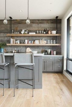 Take a look at these industrial pipe shelving ideas to see how to instantly increase the cool factor in your own home. #hunkerhome #industrialshelving #industrialbookshelf #bookshelfideas Classic Kitchen, New Kitchen, Kitchen Decor, Kitchen Ideas, Kitchen Inspiration, Kitchen Layout, Kitchen Modern, Kitchen Hacks, Modern Kitchens