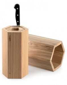 The Wrench is a nice twist on the standard knife block, replacing those dull slots with perfect geometry. Concentric, hexagonal-cross-section pieces of wood, nested and fixed in place by compressing an O-ring between each section, can store up to 12 knives in a variety of widths