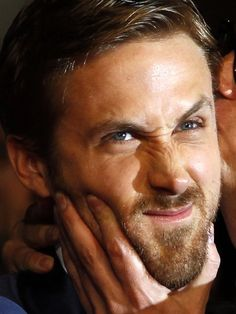 """Frowny Face  """"Hey, girl. Would you still kiss me if Imade this face all the time?"""" Ryan Gosling is not a happy camper as he walks the red carpet during the Cannes Film Festival on May 20. But, somehow, he's still irresistibly cute!"""