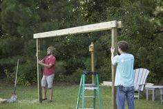 Placing posts for our pergola hammock stand in the ground.