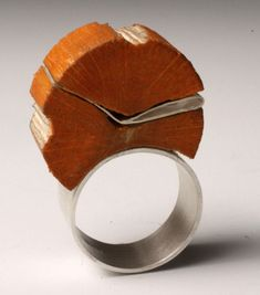 "Teresa F. Faris  Ring: Collaboration With a Bird 2009  Sterling silver, wood altered by a bird  1.5"" x .75"" x .5"""