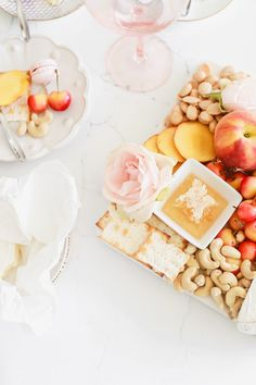 Stone fruit and cheese board with a surprise sweet element, for easy summer entertaining! #summerappetizers #charcuterie #peaches #entertaining #summerrecipes