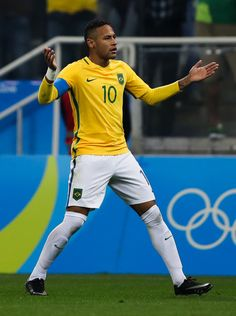 Neymar of Brazil celebrates their first goal during the match between Brazil and…