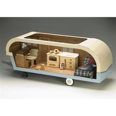 This is pretty adorable: A Miniature Travel Trailer Dollhouse!