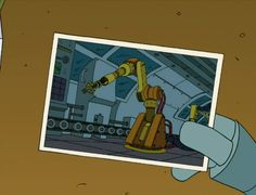 """Bender holding a photo of his """"mommy"""""""