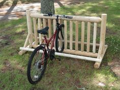 The 13 Place Log Bike Storage Rack is made of Northern White Cedar Logs. Call Log Kayak Rack today at 1 Rack Velo, Rack Bike, Pallet Bike Racks, Bike Parking Rack, Bicycle Storage Rack, Indoor Bike Rack, Kayak Storage Rack, Kayak Rack, Shed Storage