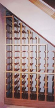 umm. i will totally be doing this when i purchase a house. (under-stairs wine storage)