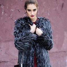 BLACK/GREY STRIPED FUR COAT OUTERWEAR SALE!! You can never go wrong with a little faux fur. Style our black fur coat with just about anything, making the whole outfit go from 0 to 100 real quick. It is the perfect signature piece to make you the center of attention. Pictures ar showing a small.  Self 80% Acrylic 20% polyester Lining 100%polyester  Grey/Black Faux Fur Coat Open front Padded shoulders Style Link Miami Jackets & Coats
