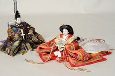 An Emperor doll with an Empress doll