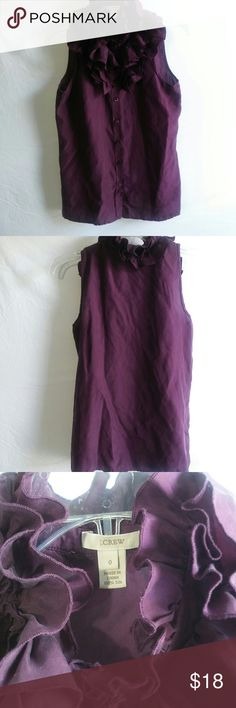 J. Crew RUFFEL 💯% silk top Gorgeous j.crew top in size small.   Deep Plum wine ruffel top  Material: 100 % silk Neck line: high Size: women's 0 = xs, s 4-6   Pit to pit- 17in Shoulder to end- 23 in J. Crew Tops