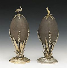 A PAIR OF SILVER MOUNTED EMU EGGS BY J. HOLT, MELBOURNE, 1879