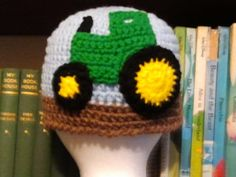 This is a precious hat for the John Deere fan in your life! This is an adult size medium, but it can be custom made to any size or color. Please specify when ordering. Let me know if you have any questions.