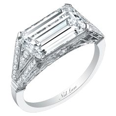 Neil Lane --I'm really starting to love emerald cut diamonds.  Love that it's set diagonally even more.