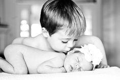 older siblings kissing newborn.  how friggin' cute is this?!