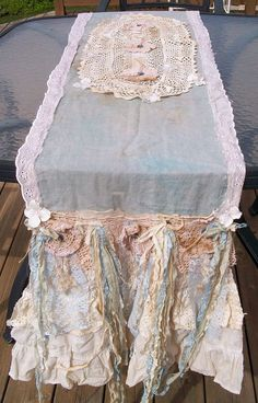 Tattered and torn table runner.