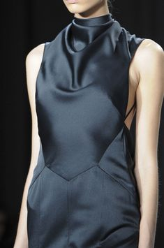 Jason Wu Fall 2014 - Fashion design details. Deep dark blue charcoal grey black silk with high cowl loose neck.
