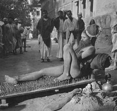 A fakir lies on a bed of nails, India, ca. 1907