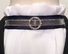 Polyester/rayon combo fabric looks and feels like light weight linen, but does not wrinkle! Navy grosgrain, navy satin metallic, and silver metallic mesh layered ribbons with small round clear rhinestone slider.  Many other ribbon color combinations available in this style. Email djdesigns56@gmail.com for more information.