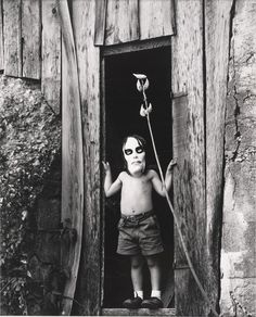 """Ralph Eugene Meatyard - - """"Untitled (Masked Boy Standing in Doorway)"""". S) Ralph Eugene Meatyard … not just some badass imagery, but one of the coolest last names in the history of art. Vintage Halloween Photos, Vintage Photos, Halloween Images, Creepy Vintage, Creepy Pictures, Creepy Old Photos, Shooting Photo, Diy Halloween Decorations, Totems"""