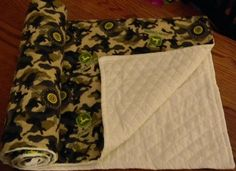 cute baby blanket.. i think you might be able to get it made with pink backing for a girl too.