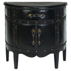 Demilune cabinet with faux leather upholstery and nailhead accents.