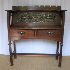 Arts & Crafts Shapland and Petterof Barnstaple two drawer oak buffet with copper stylised panel. Registered design no to back. Measures 49.5 in high x 44 in wide x 18 in deep