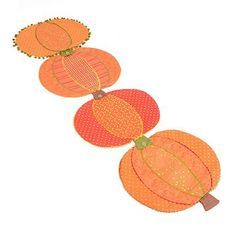 Cool product alert! Our Pumpkin Table Runner is made up of four different patterened pumpkins that can be attached with buttons! Or, unhook them and use them as individual place mats! #kirklands #harvest