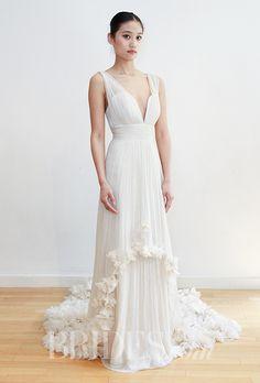Brides.com: . Chiffon sheath with plunging neckline and floral appliqués at the hem, Leila Hafzi
