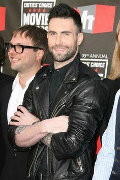 Adam Levine .  NICE HAIR!!